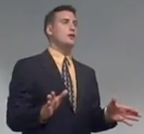 Kristoffer Thompson speaking to an audience